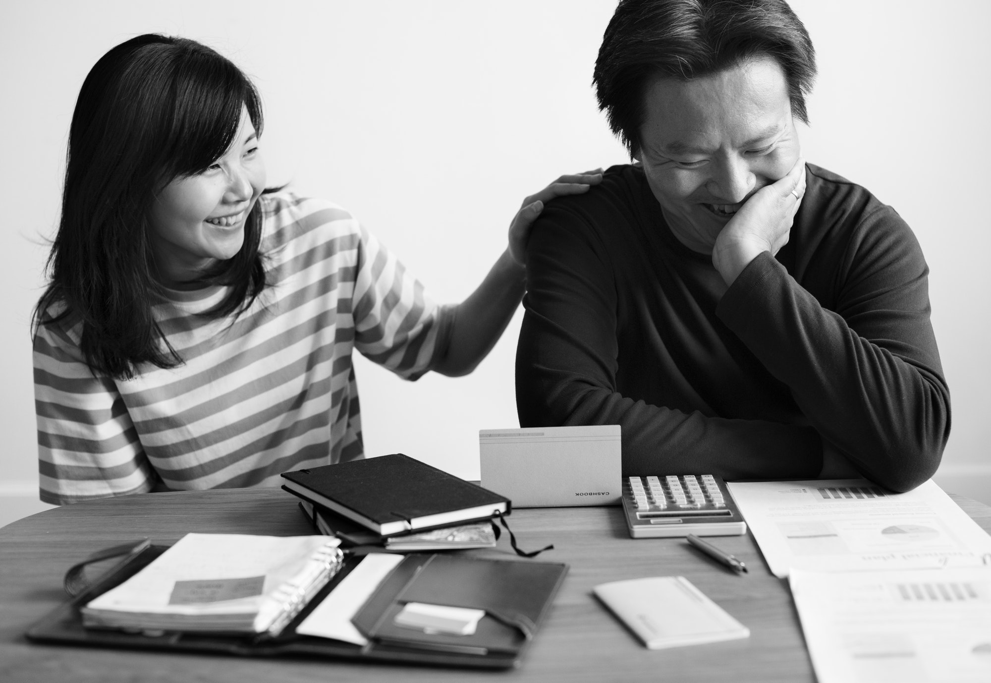 Asian couple planning for the investment